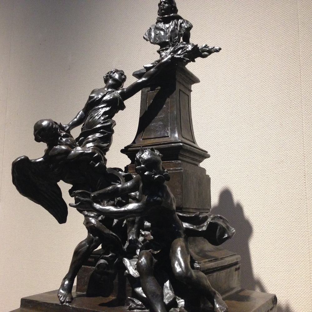 """Maquette for the Delacroix Monument"" by Aimé-Jules Dalou (1885)   This maquette, cast in bronze, is a miniaturization of a monument to French artist Eugene Delacroix. The monument was commissioned in 1885 by the French government in an attempt to stir nationalist pride post-1870 Third Republic transition. For the history alone, this piece interests me - the fluidity of the characters (and the starkness of a complex, black figurine against a stark gallery wall) is what made it a stand out. More on Aimé-Jules Dalou  here ."
