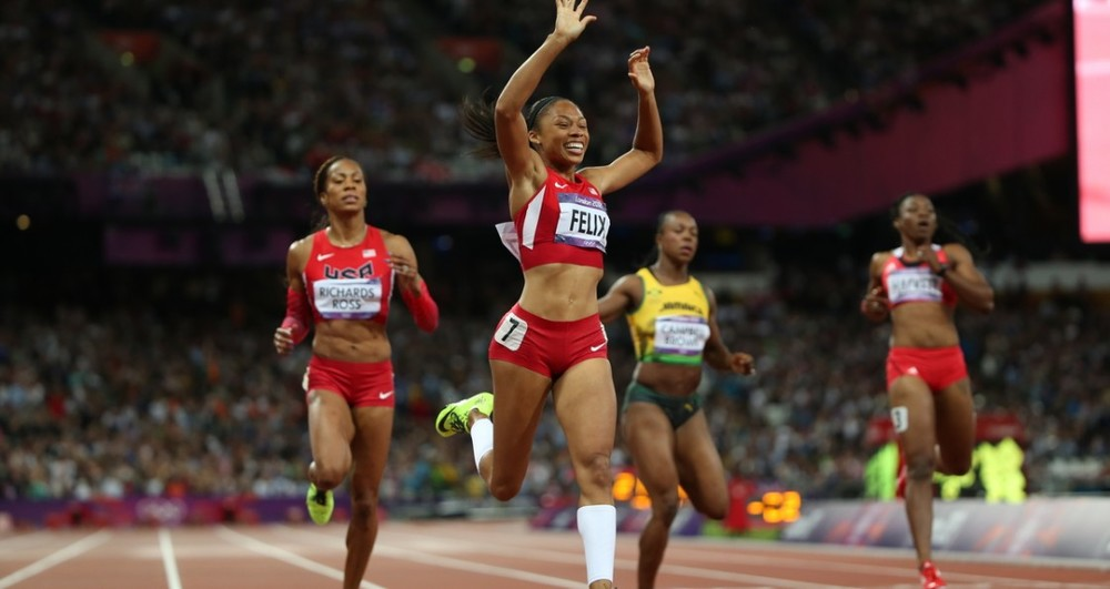 Allyson Felix wins the Women's 200m Gold in Nike Flyknit spikes (photo: playerstribune.com)
