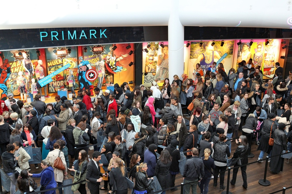 A mob of shoppers outside of a Primark store, enticed by prices as low as €3 for a t-shirt (photo: retail-week.com)