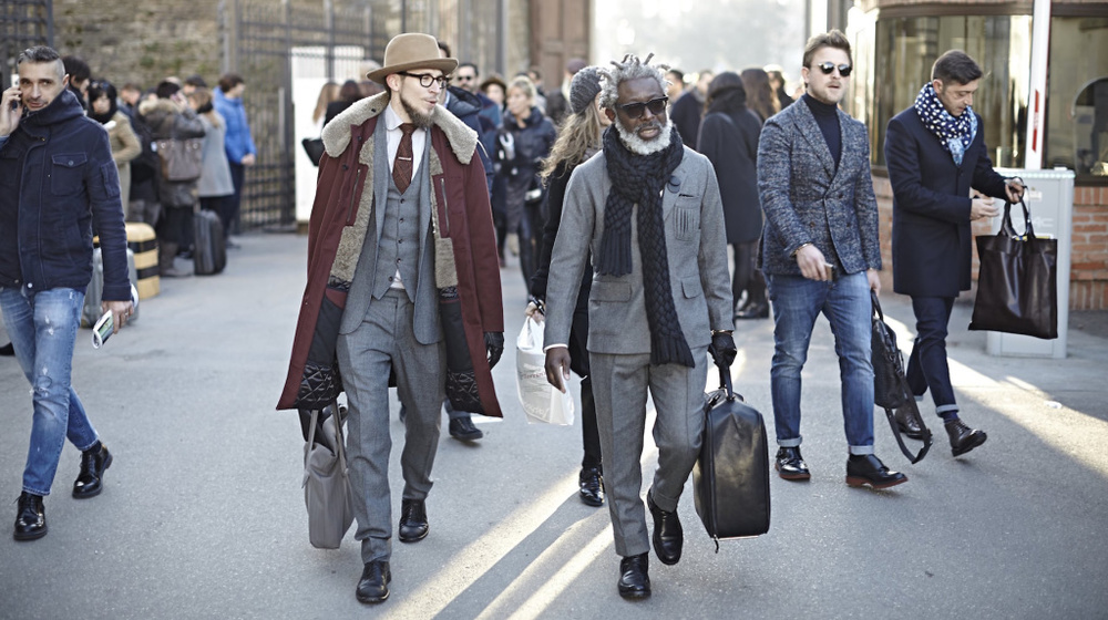 "The expression of the man on the left is a wonderful visualization of what ""losing the effect"" feels like. Even at Pitti, context counts."