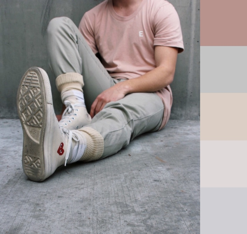 From unrelated colors to Hapsburg twins: low value, low saturation, relatively warm colors in descending intensity. The outfit itself is almost a gradient, from red all the way through beige and finally white shoes.