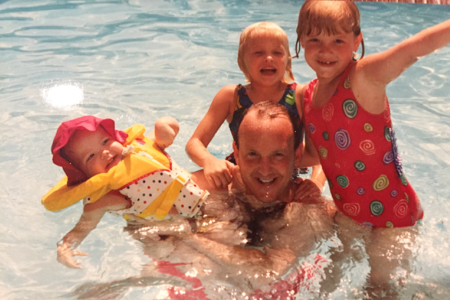 Haley (on the right) swimming with her dad and siblings