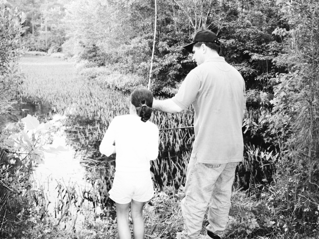 Sarah and her dad bass fishing, their favorite outdoor hobby, in rural North Carolina