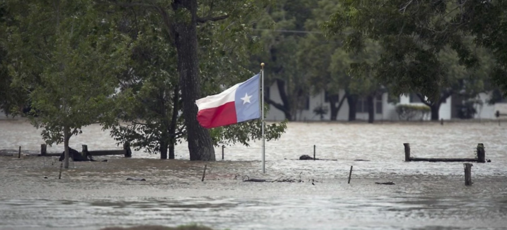 A Texas flag over floodwaters in LaGrange, TX. (AP)