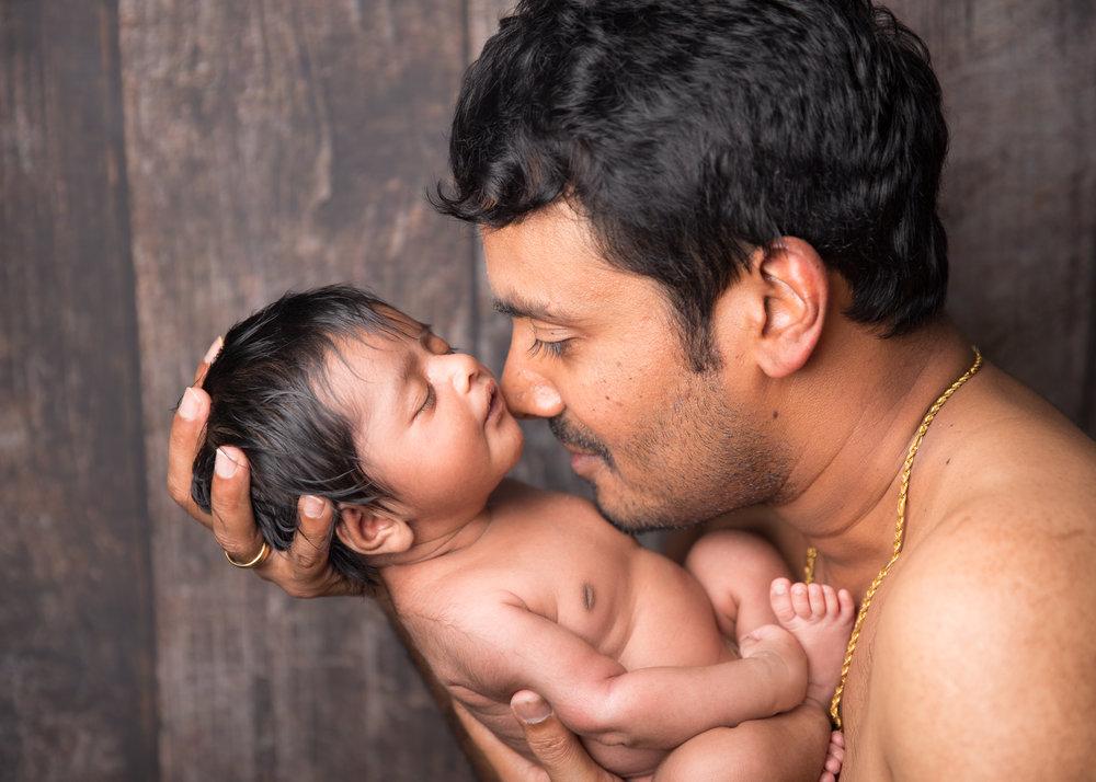 tender-moment-parent-child-newborn