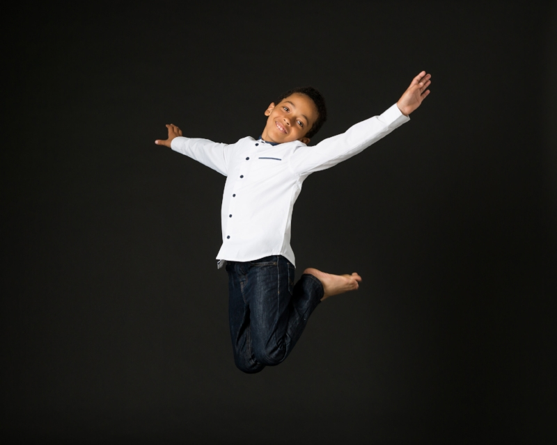 older boy, jumping for joy