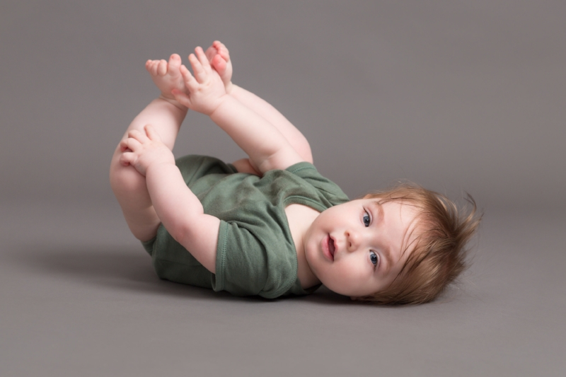 baby on back portrait, holding feet