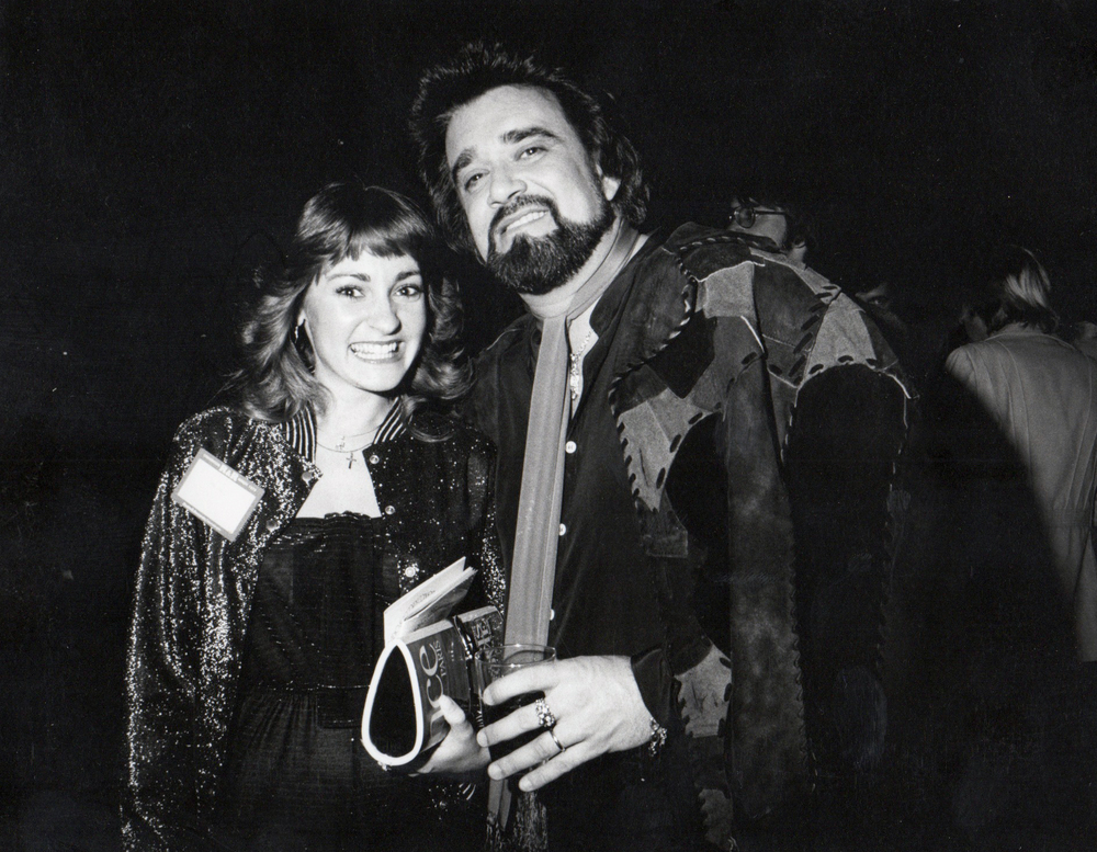 "Joni pictured here with the late, great radio personality and icon, ""Wolfman Jack."""