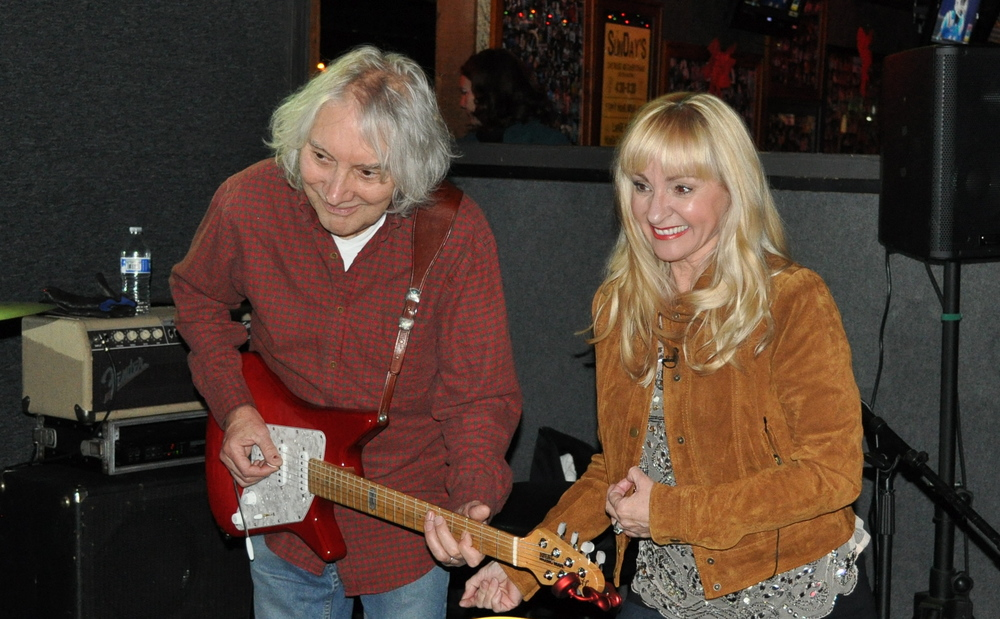 Playing air guitar along side of Albert Lee