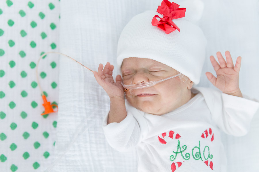 27 Week Preemie Twin Ada Smiling in Christmas Outfit