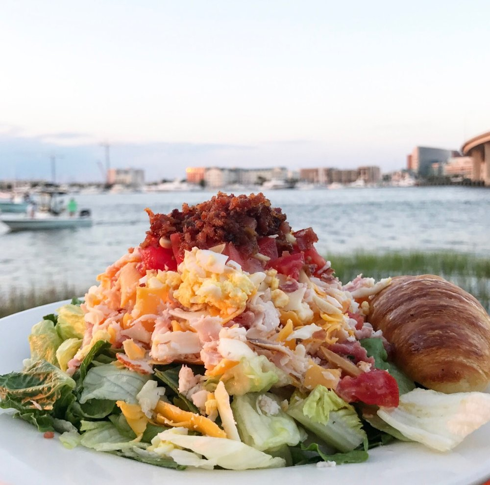 Hands down, best views on the water. They're famous for this cobb salad and we never order salads soooo that's saying something. BTW, don't skip out on that croissant....If you make good enough friends with your waitress, she will send you home with 2 to-go boxes full for drunk eating later!