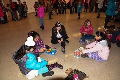 Helping kids in need wrap Christmas Presents