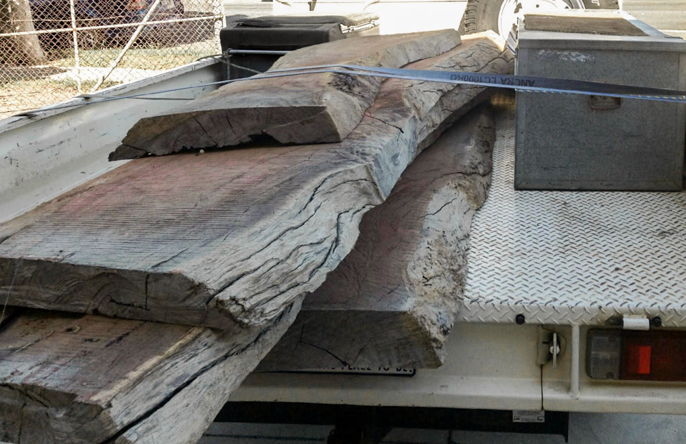 Red Gum slabs, a tree native to Australia, ready to be polished into tap room bar tops.