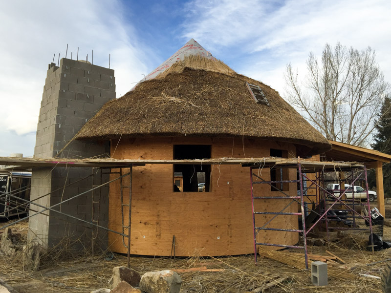 Thatching the 'Witches Hat' at our Animal House project