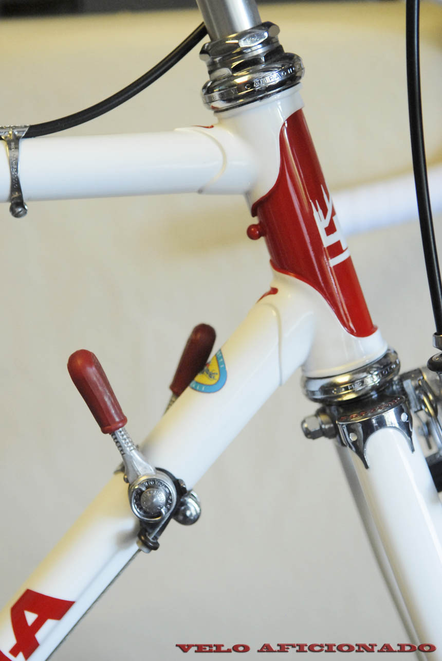 Red and white replica of Eddy Merckx's famous Faema race bike