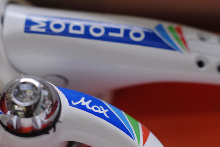 Modolo Max brakes, blue green and red graphics on white.