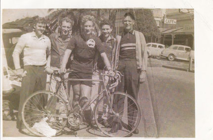 "Group at Brisbane to Warwick, Record ride by Jeff Mason 1960.  Caption reads on verso ""A. Dows Trainer and Masseur."""