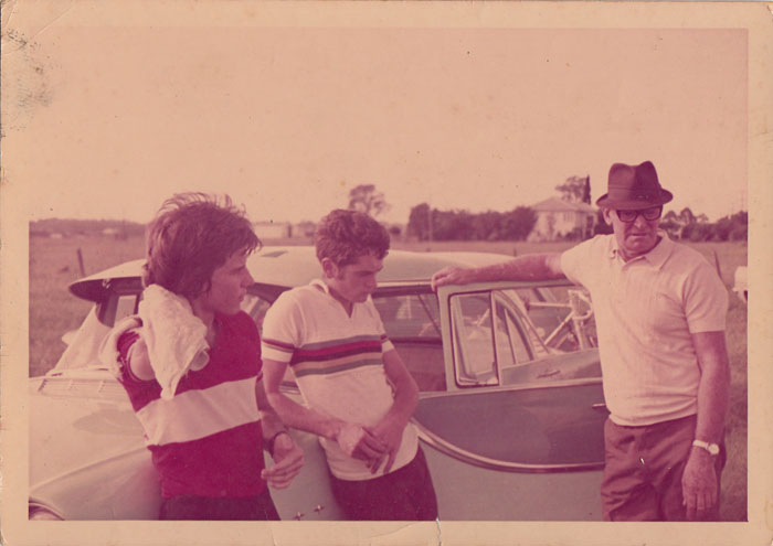Joe Cosgrove and Mark Brink with Arthur Dows and Arthur's FB holden at Bald Hill Flats, February 1972 after being trained up like demons by Arthur. At the state selection race for Olympic trials.