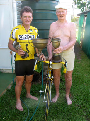 Joe Cosgrove and Artur at Woody Point with some of Arthur's old cycling trophies.