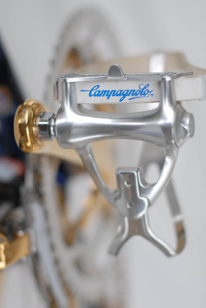 Campagnolo white leather toe straps with plastic toe strap ends.