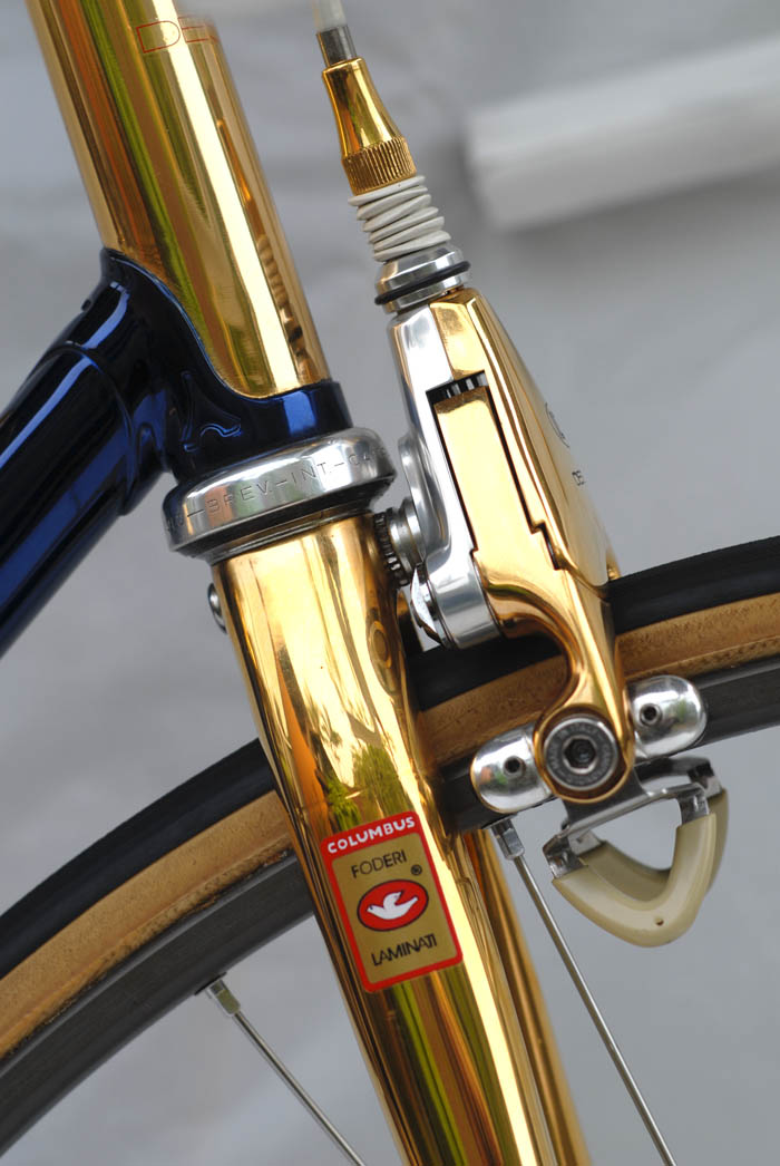 Campagnolo Delta brakes side view. ICS gold plating blended with original Campagnolo factory anodising.