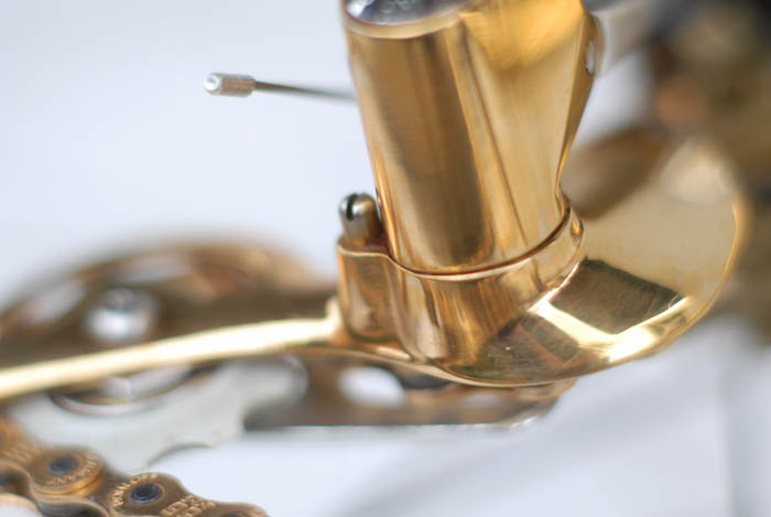 Close up of Corsa Record 2nd gen rear derailleur, with gold plated parts.