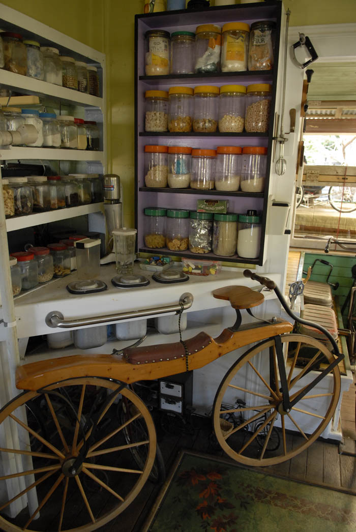 Dandy horse tethered to the kitchen bench. A replica  from the bicycle collection of the late James Macdonald of Toowoomba.