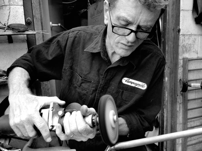 Joe has his own methods from years of experience. Be very careful not to damage yourself or the piece that you are working on. Those metal parts of the grinder can damage your frame in the blink of an eye. If in doubt practice first before attempting to work on your special vintage bicycle.