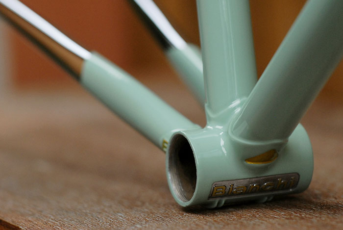 Celeste Bianchi investment cast bottom bracket with chrome and gold detailing.