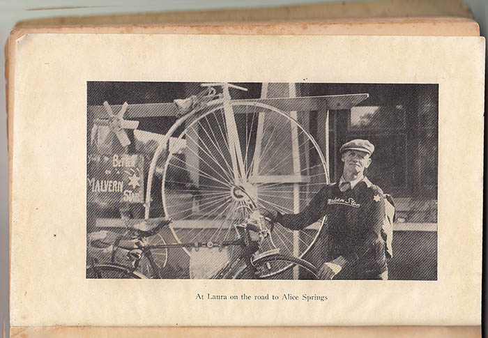 Ernie Old with his Malvern Star Semi racer bicycle. The Cyclo style three or four speed gear lever is fitted to the top bar. The old style bidon cages are mounted to the handlebars, these are not present on the bicycle at the National Museum.