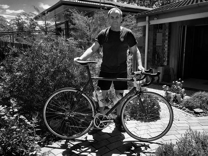 Darrell McCulloch outside the Llewellyn Custom Bikes workshop with Bob's Cadenzia. Photo by Bob Christiansen.