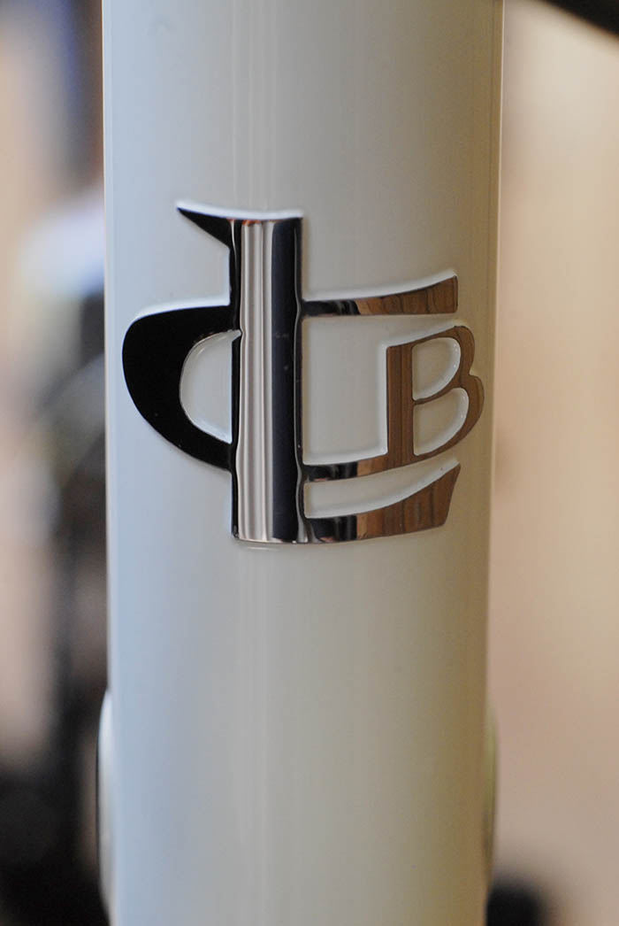 Polished stainless steel Llewellyn bikes head badge.