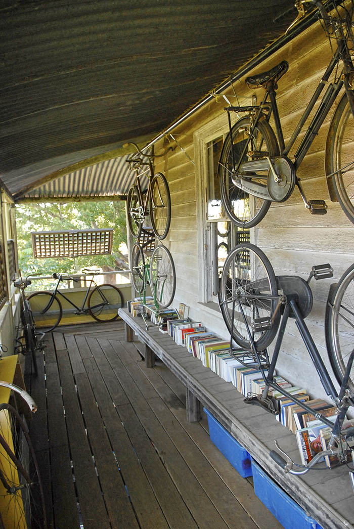 "Old bikes hung and leant against walls on the spacious Toowoomba ""Queenslander"" verandahs."