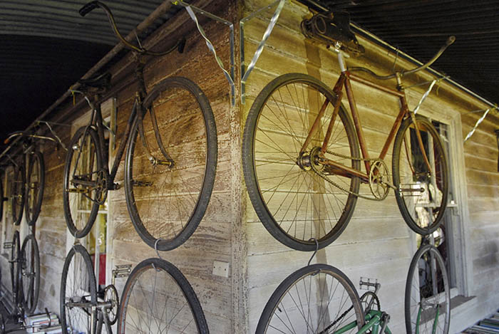 Verandah walls hung with old bicycles.