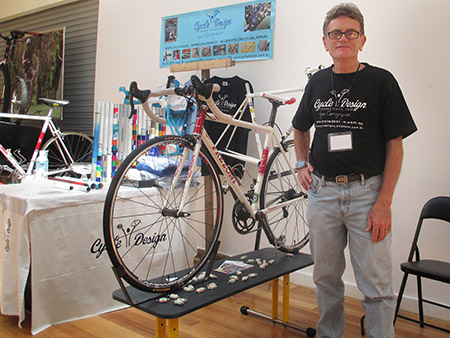 Joe at the Melbourne bike show shortly after his red and white Faema styled bikes were completed. Already forming a bond with the Merckx inspired Faema styled Frezoni. Photo by Evelyn Cosgrove