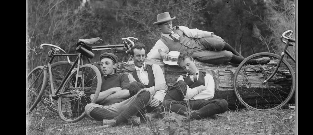 Tired riders fall about laughing after a successful urban raid. One rider falls asleep after a night on the nest then bragging to his mates about his escapades for the entire ride. Image by Mark James Daniel 1867-1949 State Library of Victoria.