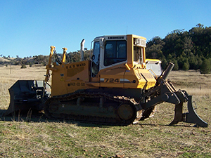 Preparing the site for trenching and installation of water tanks.