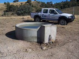 "Stock water scheme at ""Box Park"" Barraba – 98,000lts Rhino storage tank supplied from bore 150mts down in valley."