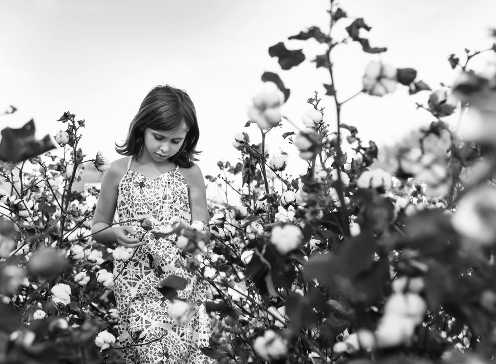 Lauren walking through cotton fields in South Alabama... age 8.
