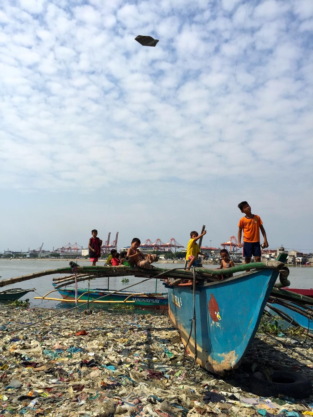 Baseco playtime on a bangka (boat)