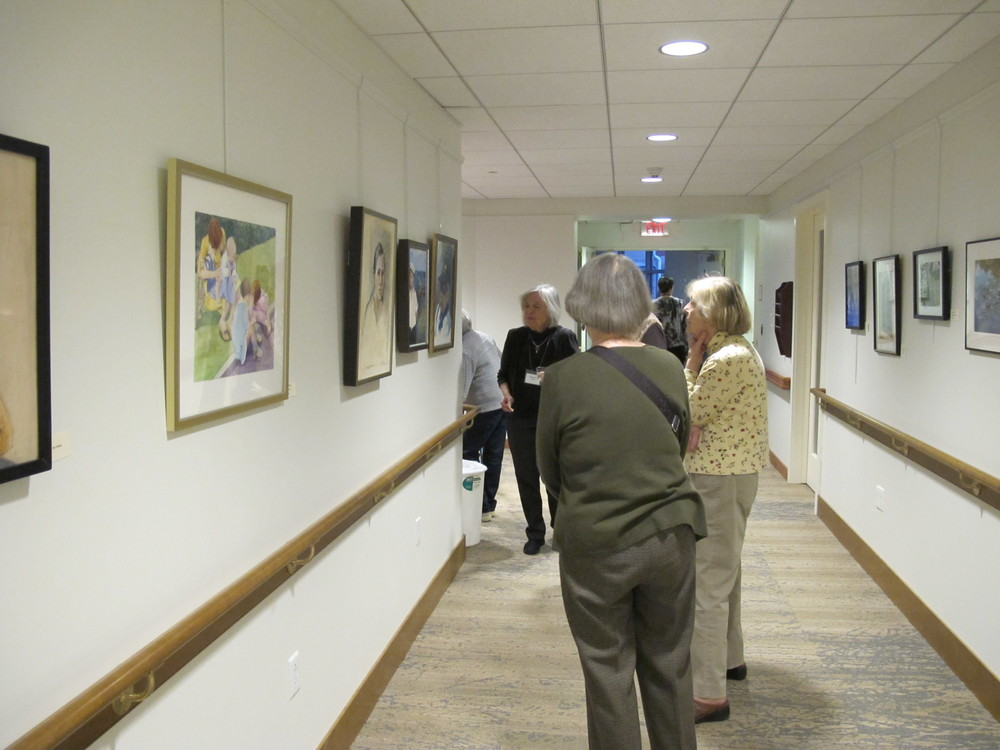 Residents gathering to see a recent exhibit of resident artists' work