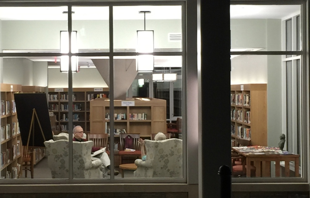 Library lit up at night, seen from outside