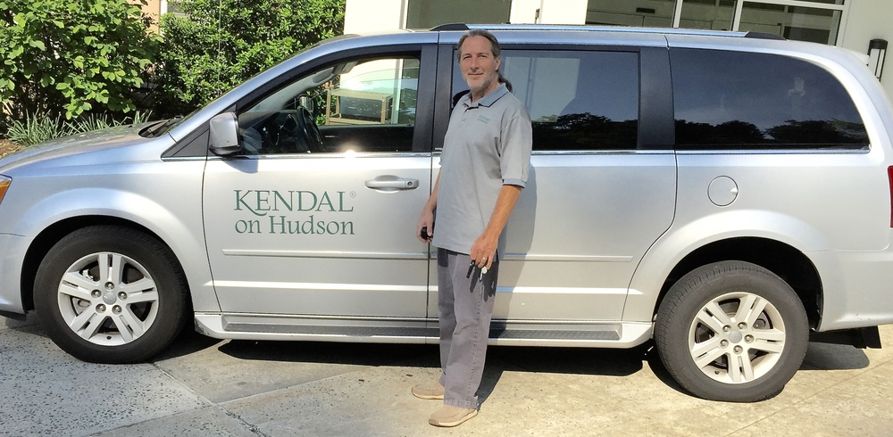 Rich Shields, Kendal's driver since 2005, with one of the vans .