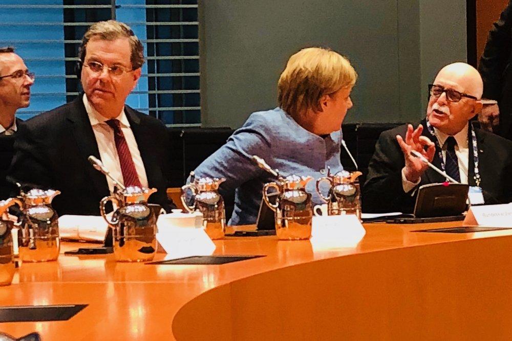 Gene DuBow with Chancellor Merkel