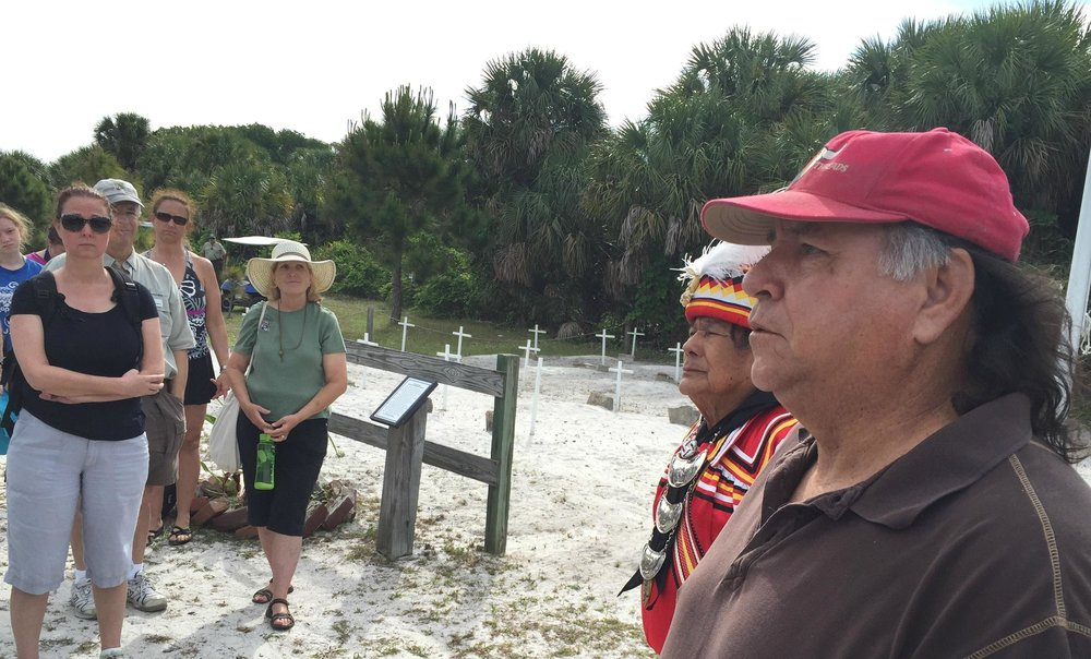 Bobby Henry, cultural adviser to the Seminole Tribe of Florida, stands next to Willie Johns, Chief Justice of the Seminole Courts, near a cemetery on Egmont Key. The island served as a detainment camp for Seminoles in the 1850s before being sent to the West. CREDIT TOPHER FORHECZ/WGCU. Link to post at WGCU.