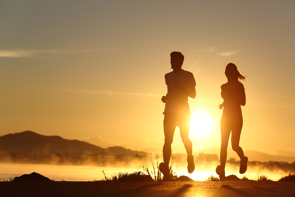 Silhouette of a couple running at sunset[1].jpg