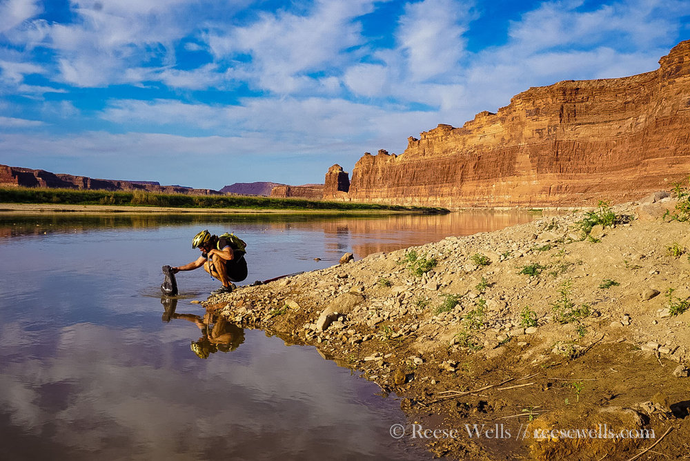 Tyler fishing for water on the Colorado River. This photo taken near Hite, Utah at the east end of Glen Canyon.