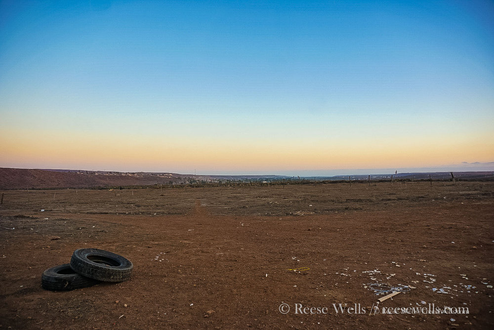A lonely view in Puerto Colonet. I like this photo because of the emotional contrast between the sunset and the discarded tires.