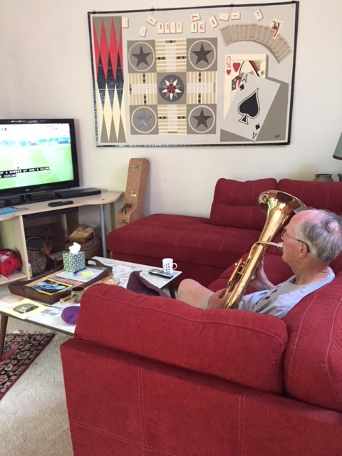 Brother Robert, a musical Hogan, watching the World Cup and practicing his Tenor Horn for family gigs all weekend long, including Mr. W on guitar and uke.