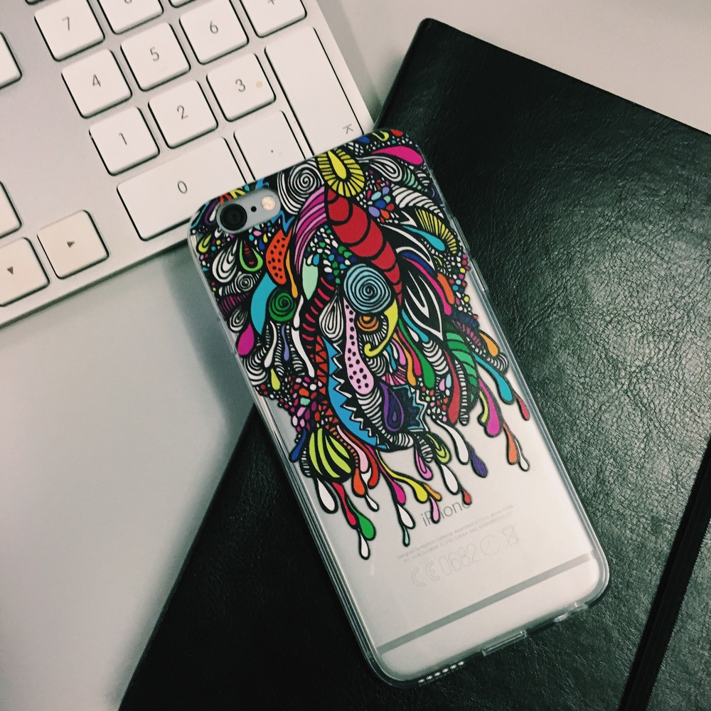Inkase Doodle iphone case on desk with apple keyboard and notebook